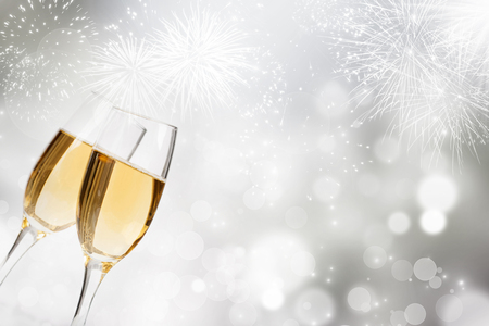 Glasses with champagne against fireworks and holiday lights Banque d'images