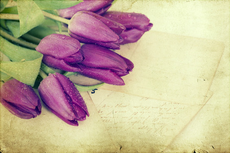 Old love letters and purple tulips. Retro style toned picture photo