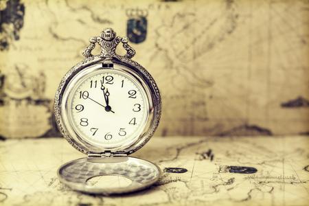 pocketwatch: Vintage watch on antique map. Retro still life