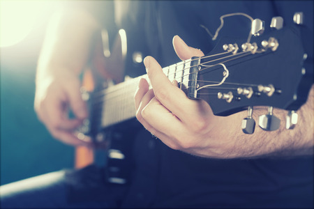 music player: Guitarist on stage in the stagelight