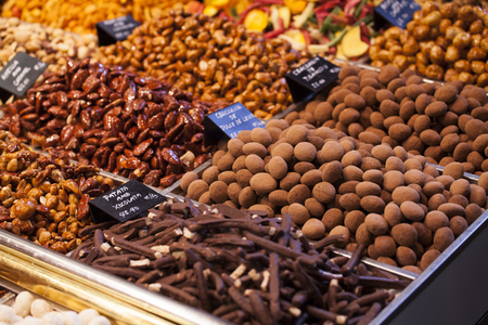Gourmet assorted truffles exposed in a market photo