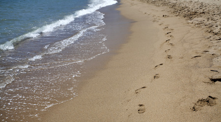 footsteps: Footsteps in the sand at the beach - retro styled photo