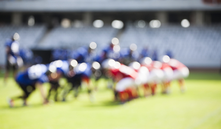 professional football: American football game - out of focus background of the field Stock Photo