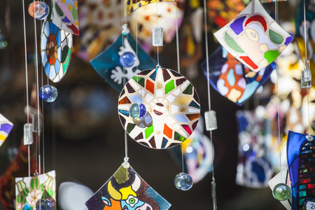 wind chime: Colorful glass wind chime hanging outside, shallow focus Stock Photo