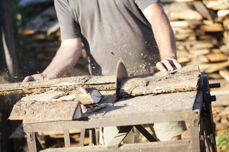 lumberman: Lumberman working on the circular saw