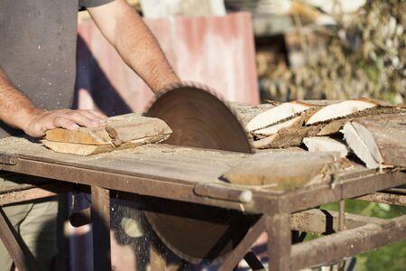 circular saw: Lumberman working on circular saw
