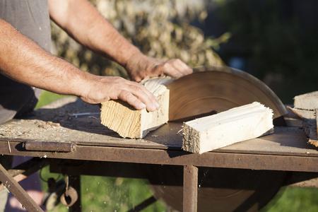lumberman: Lumberman working on circular saw