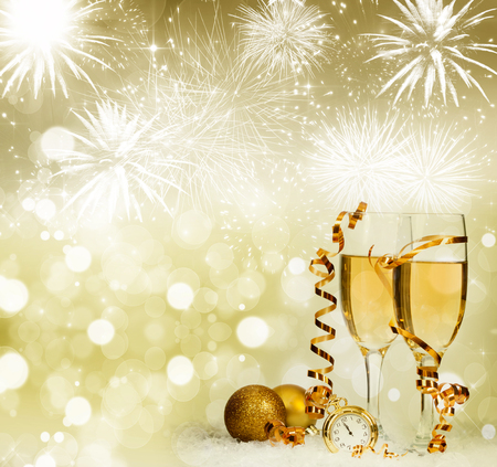 Glasses with champagne and Christmas decoration against fireworks and holiday lights Archivio Fotografico