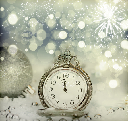 old new: New Years at midnight - Old clock with fireworks and holiday lights Stock Photo