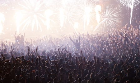 cheering crowd: New Year concept - cheering crowd and fireworks at New Year