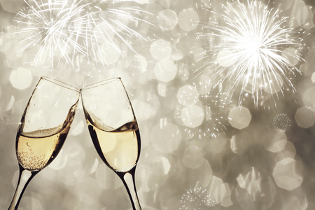 new year: Champangne glasses on sparkling background - New Year concept