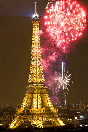 evening: Eiffel tower with fireworks, celebration of the New Year in Paris, France - retro styled photo
