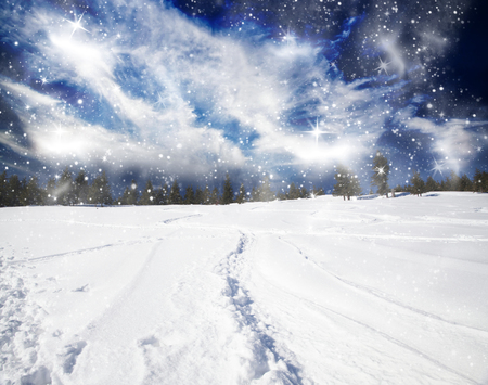 trek: Christmas background with snowy path on the hillside