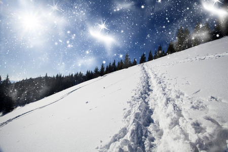 hillside: Christmas background with snowy path on the hillside