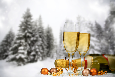 champagne: Christmas decorations in front of snow cowered winter background