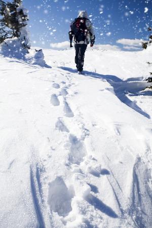 lonley: Lonley hiker climbing in the winter mountains