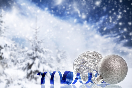 frosty: Christmas decorations in front of snow cowered winter background