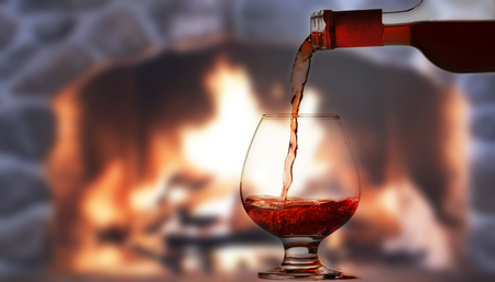fireplace: Pouring wine by the fireplace