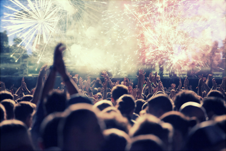 Cheering crowd and fireworks at New Year's Eve