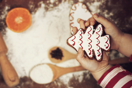 recipe decorated: Christmas preparations concept- gingerbread cookies, spices and flour over wooden background