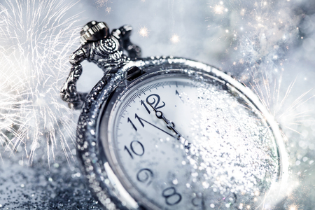 past midnight: New Years at midnight - Old watch with stars, snowflakes and holiday lights