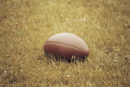 pumped: American Football lying on the ground