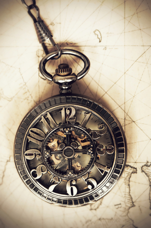 antique map: Vintage clock on antique map. Geographical discovery concept Stock Photo