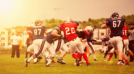 Blurred background of american football game action Stock Photo
