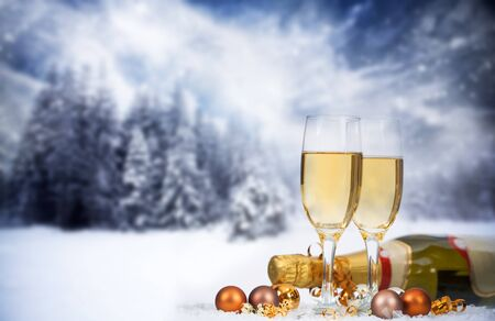 Christmas decorations in front of snow cowered winter background