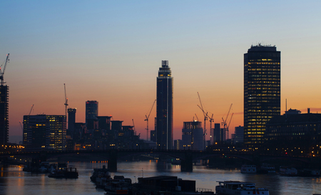 Silhouette of the City of London business and financial aria view in the sunset