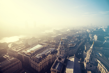 st pauls: Aerial London view on a foggy day from St Pauls cathedral - vintage styled photo