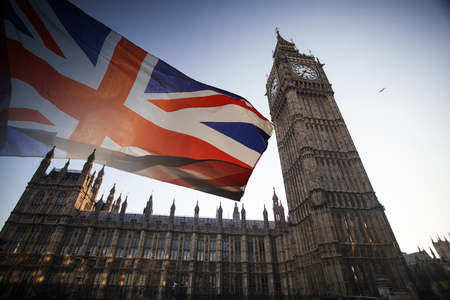 British union jack flag and Big Ben Clock Tower and Parliament house at city of Westminster in the background Stock Photo