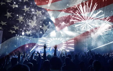 old glory: Crowd of people celebrating Independence Day. United States of America USA flag with fireworks background for 4th of July Stock Photo