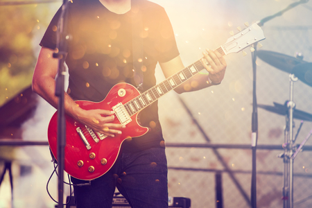 Guitarist in stage lights Stock Photo