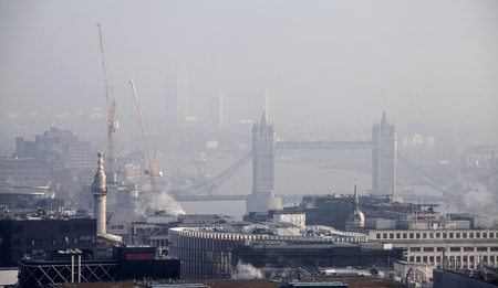 st pauls: Tower Bridge in the fog.Rooftop view over London on a foggy day from St Pauls cathedral, UK Stock Photo