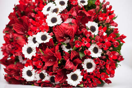 Red wedding bouquet on white background