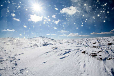 Snow covered hillside in the high mountains in bright daylight