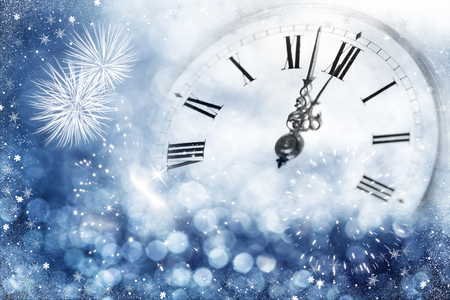 New Years at midnight - Old clock with stars snowflakes and holiday lights