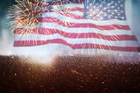 Crowd of people celebrating Independence Day. United States of America USA flag with fireworks background for 4th of July Banco de Imagens