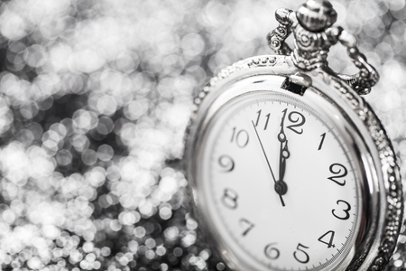 Old silver watch closeup at midnight -New  Year concep