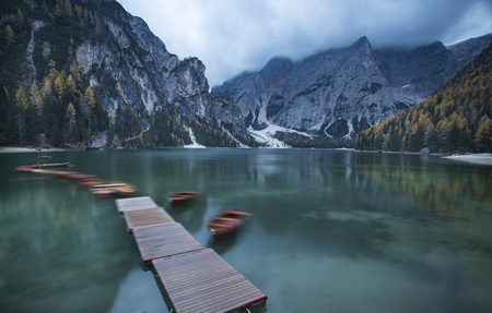 Amazing view of Lago di Braies (Pragser Wildsee), one of the most beautiful lake in South Tirol, Dolomites mountains, Italy. Popular tourist attraction. Imagens