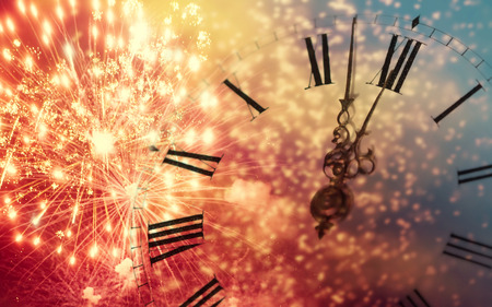 New Years at midnight - Old clock with fireworks and holiday lights Stock Photo