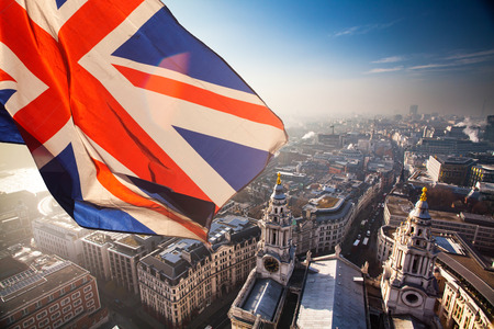 British union jack flag and aerial view of London - UK living the EU concept