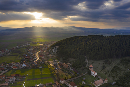 Aerial drone view of beautiful sunset over a small village in Transylvania. Stok Fotoğraf - 123213955