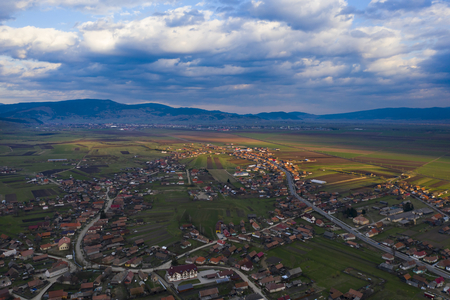 Aerial drone view of beautiful sunset over a small village in Transylvania. Stok Fotoğraf - 123214115