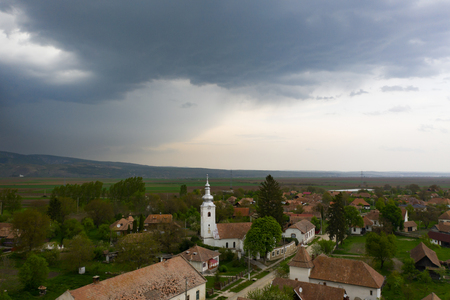 Aerial drone view of  a small village and his church before stom Stok Fotoğraf - 123216388