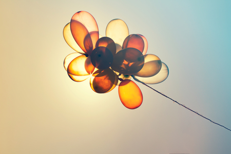 Colorful balloons on blue sky -  retro effect.Concept of love in summer, valentine, wedding and honeymoon.