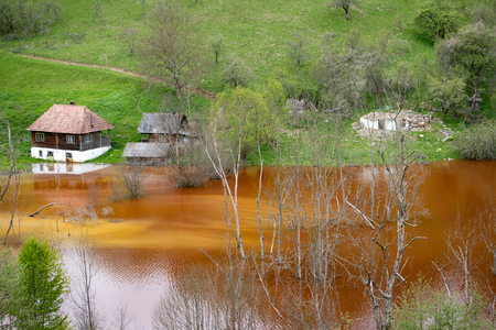 Flooded and abandoned village in the middle of a lake contaminated with cyanide at Geamana, near Rosia Montana, Romania.