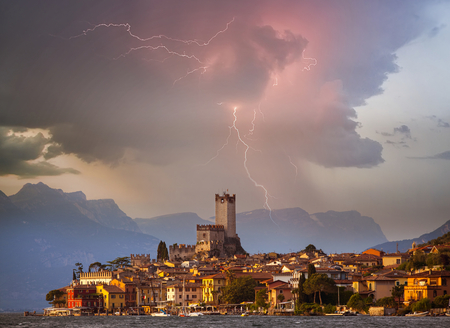 Town of Malcesine on Garda Lake in stuning stormy sunset, Veneto region of Italy 版權商用圖片