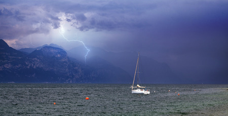 Lonely boat in summer storm